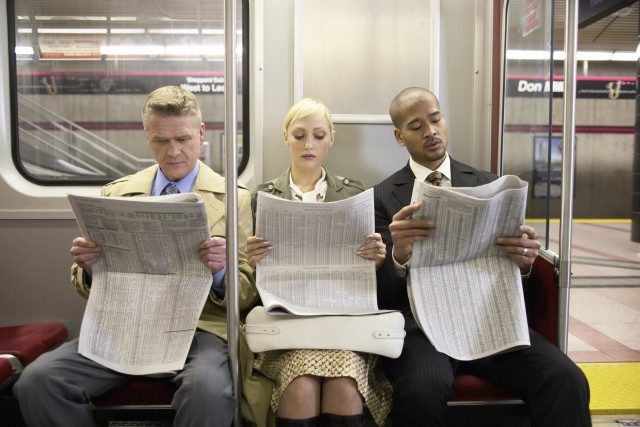 People reading on subway